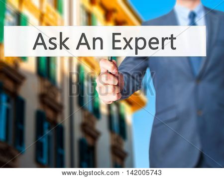 Ask An Expert - Business Man Showing Sign