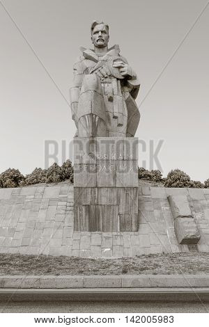 NOVOROSSIYSK RUSSIA - AUGUST 3 2016: a monument to the sailors of the revolution near the highway in Novorossiysk city in summer Russia. black and white monochrome photo