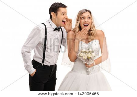 Young newlywed couple gossiping among each other isolated on white background