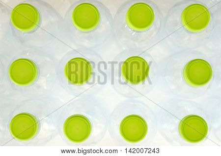 top view of white plastic bottle with green lid