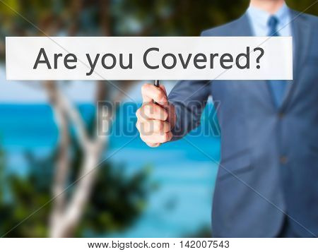 Are You Covered ? - Business Man Showing Sign