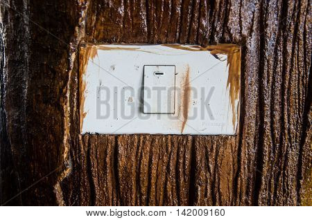 light switch on the wood wall in home