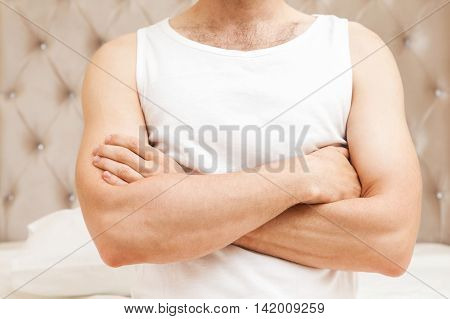 Young Male Torso With Crossing Hands