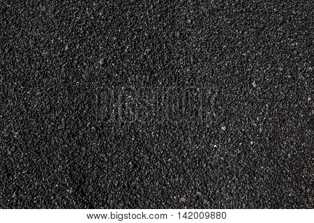 Black raw asphalt stones texture or background