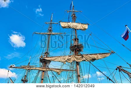 Masts of the frigate against blue sky