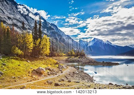 The path on the banks of shoaled Medicine Lake. Autumn in Jasper National Park, Canada