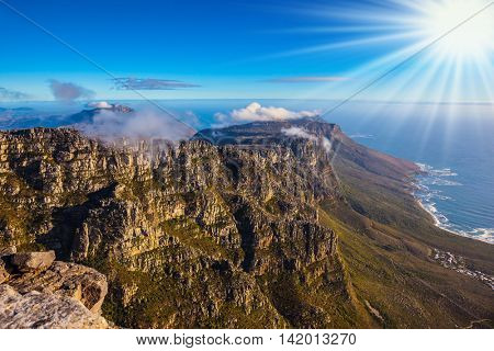Walk on top of Table Mountain at sunset. The concept of active tourism and recreation. Travel to Africa