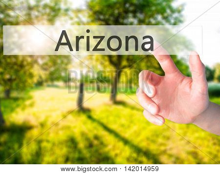 Arizona - Hand Pressing A Button On Blurred Background Concept On Visual Screen.
