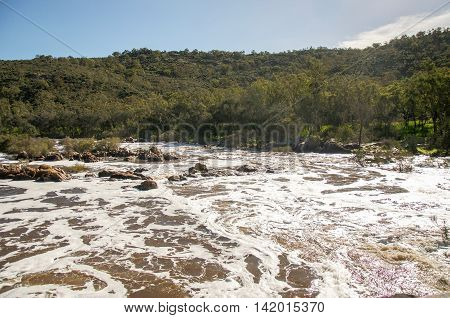 Lush peaceful landscape surrounding the white waters of the Bell Rapids in the Swan Valley in Western Australia.