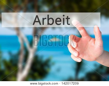 Arbeit (work In German) - Hand Pressing A Button On Blurred Background Concept On Visual Screen.