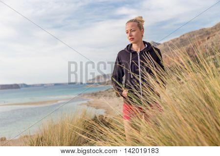 Relaxed Happy Woman Enjoying Walk On Beach
