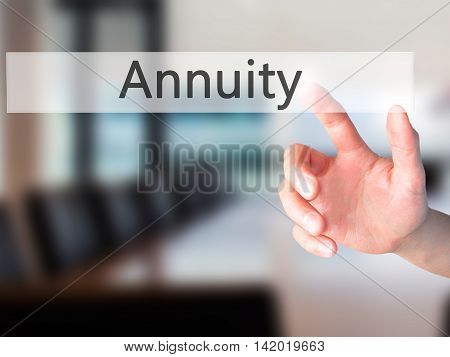 Annuity - Hand Pressing A Button On Blurred Background Concept On Visual Screen.