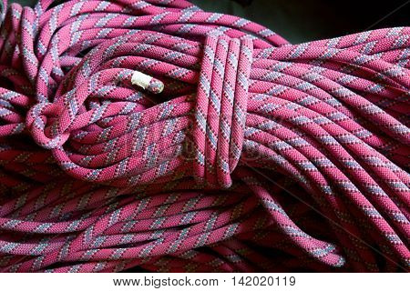Pink climbing rope close up.