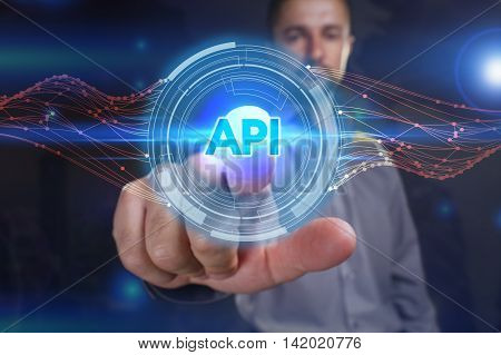 Business, Technology, Internet And Network Concept. Young Business Man Chooses The Virtual Screen: A