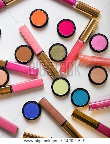 Make-up eye shadows with lip gloss. View from above.