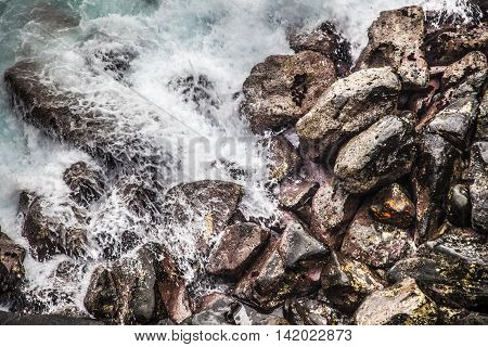 Waves Hitting Rocks During A Storm