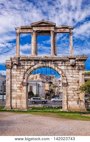 Arch Of Hadrian Against Parthenon Temple On The Acropolis In Athens, Greece