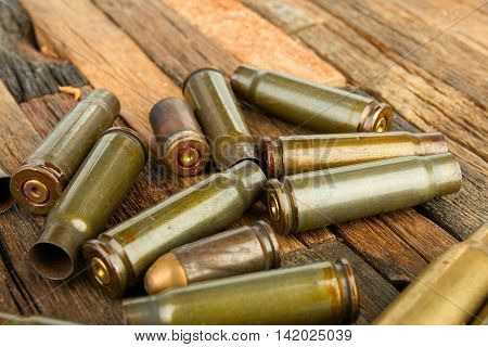 Bullets shell on wooden background.  Stock image macro.