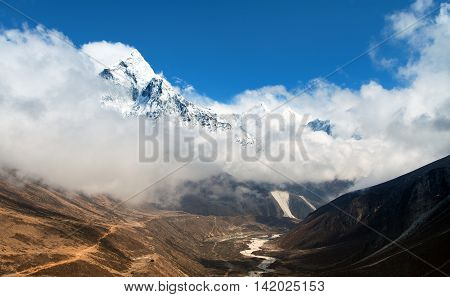 Mount Ama Dablam within clouds way to Everest base camp Khumbu valley Sagarmatha national park Everest area Nepal