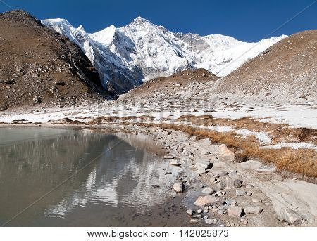 view of Cho Oyu mirroring in lake - Cho Oyu base camp - Everest trek - Nepal