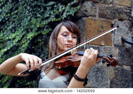 Playing violinist on the grunge background