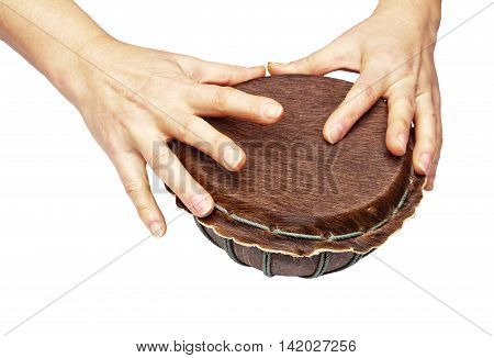 Woman hands is on drum isolated on white