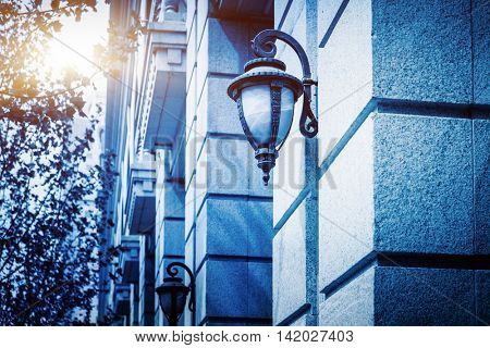 row of lamps mounted on wall of building