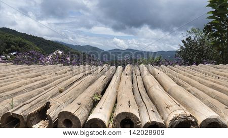 Wooden Bamboo Table With Verbena Flower And Mountain For Montage Your Product