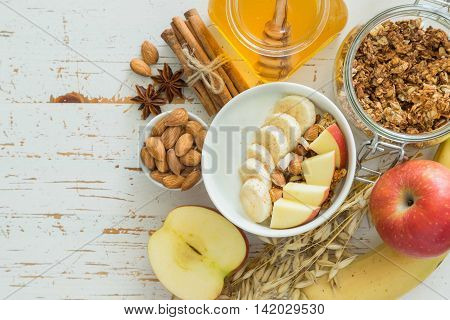 Autumn granola with banana apples and almond, copy space