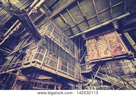 Vintage Toned Abandoned Industrial Interior.