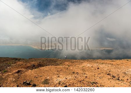 misty view on neighboring isle coastline and the sea from Lanzarote, Canary Isles, Spain