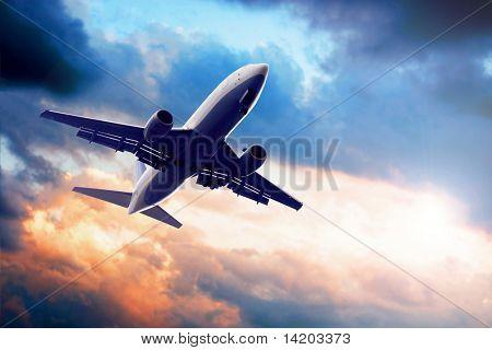 Airplane on blue sky