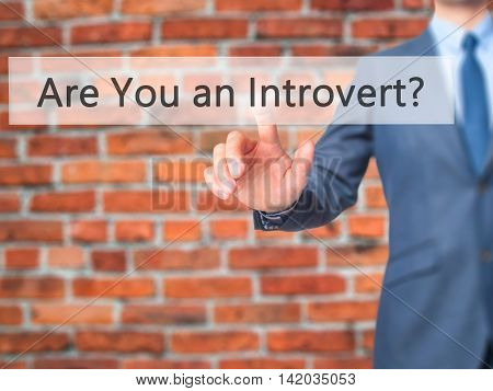 Are You An Introvert ? -  Businessman Press On Digital Screen.