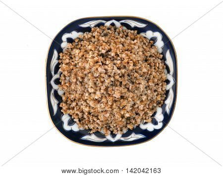 Beautiful dish with buckwheat on a white background. View from above