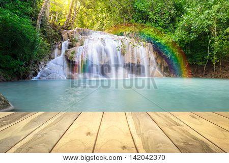 Scenery of Erawan waterfall montage with wood floors.