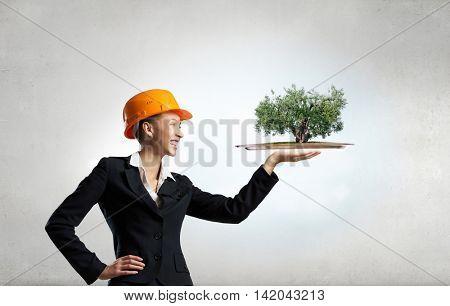 Elegant engineer woman . Mixed media