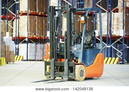 Pallet forklift truck at warehouse