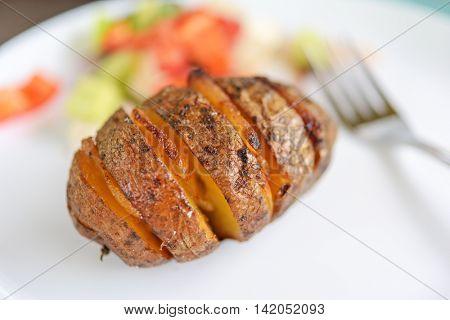 baked potato with bacon closeup