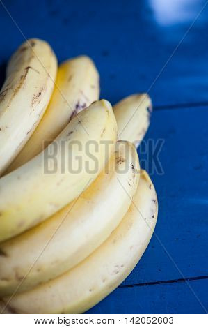 Close up of bananas on a blue background