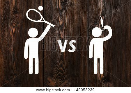 Paper man with tennis racquet vs smoking. Abstract health and sport conceptual image