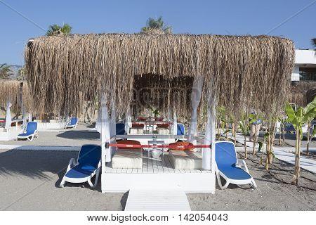 CAMYUVA KEMER TURKEY - JULY 14 2015: Beach gazebo with lounge chairs by the sea in Camyuva
