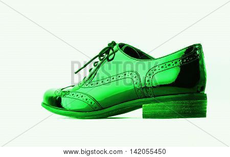Footwear Concept. Horizontal Image. Pair of green female classic leather shoes isolated on the white background.