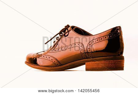 Footwear Concept. Horizontal Image. Pair of orange female classic leather shoes isolated on the white background.