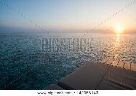 Sunrise with sea view sun bed Maldives