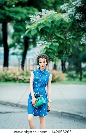 Beautiful Girl In Blue Dress In The Crosshairs With Purse