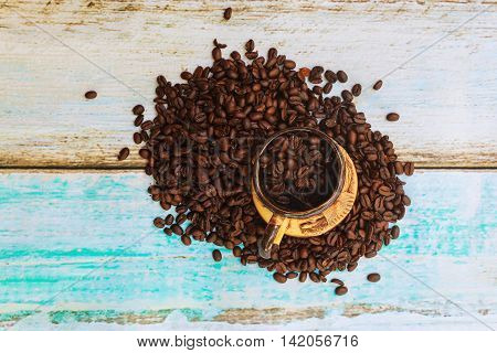 Roasted Coffee Beans And A Cup