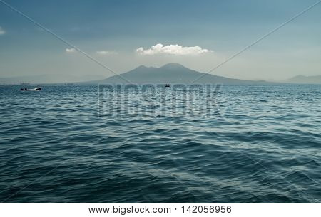 A sea view of Mount Vesuvius with boats