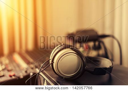 Headphones with amplifier on table with copy space soft focus vintage tone