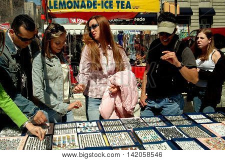 New York City - April 16 2005: People shopping for rings sold by a vendor at an Upper West Side Street Festival