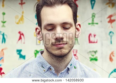 Portrait of a upset white young man looking down